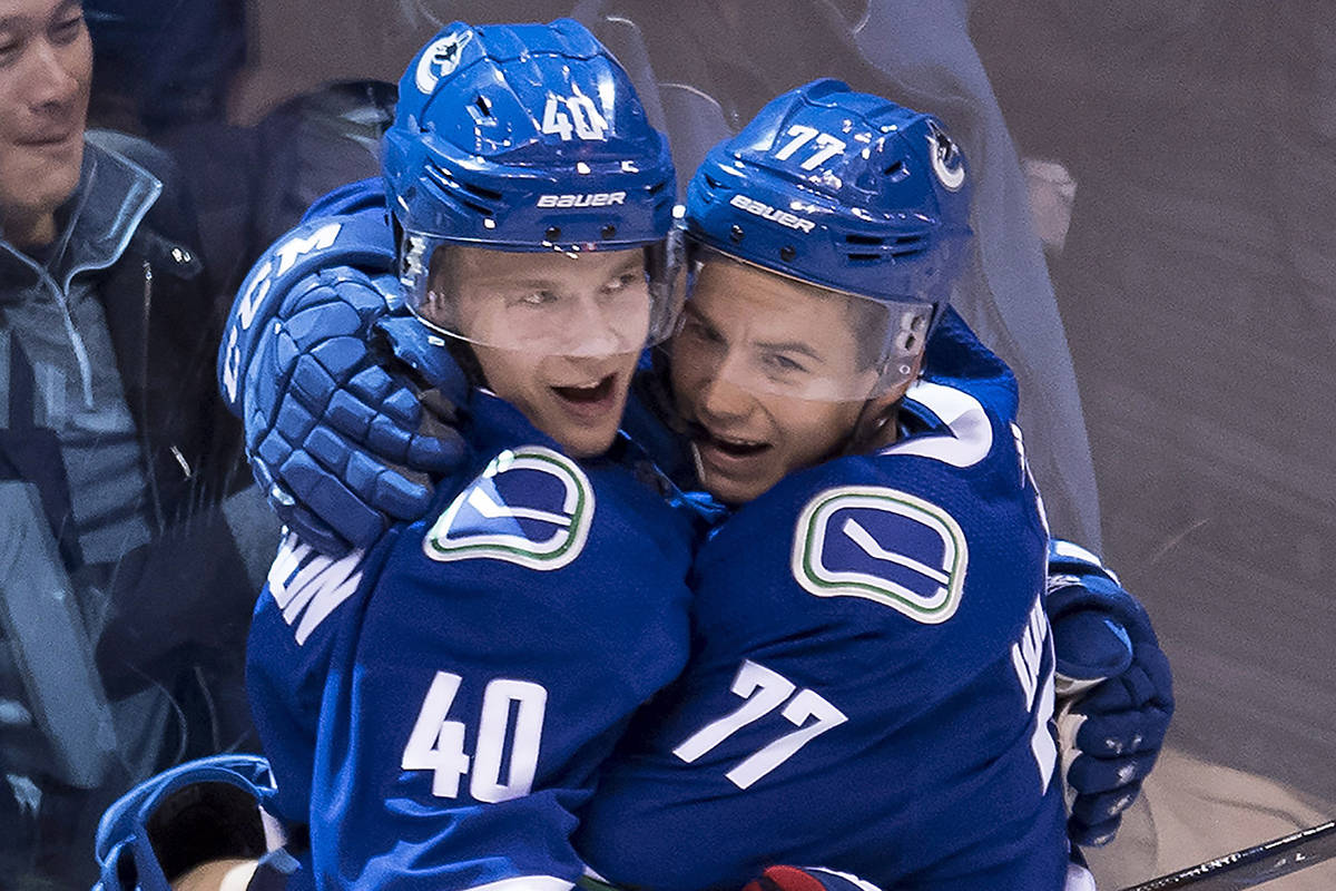 Vancouver Canucks right wing Nikolay Goldobin (77) celebrates his goal with teammate Vancouver Canucks centre Elias Pettersson (40) during third period NHL action at Rogers Arena in Vancouver, Wednesday, Oct, 3, 2018. THE CANADIAN PRESS/Jonathan Hayward