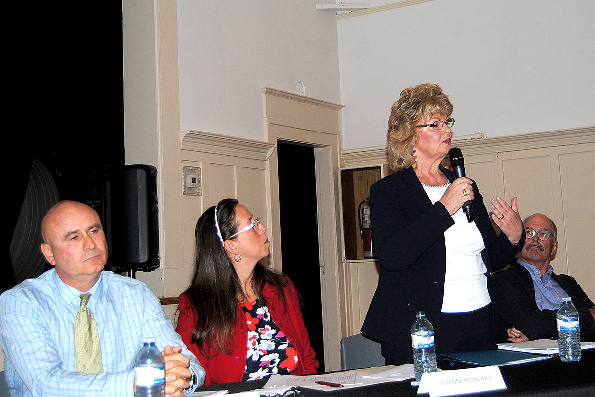 Cheryl Snowdon-Eddy speaks at the Fort Langley candidates' meeting Thursday. Listening are fellow candidates for the Langley Board of Education (from left) David Tod, Suzanne Perreault and Rod Ross. Also running are Megan Dykeman, Brent Larsen and Marnie Wilson. (Frank Bucholtz/Black Press)