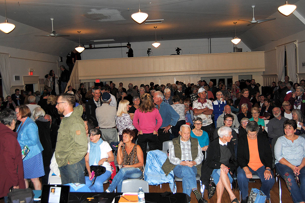 Fort Langley Community Hall was packed, with many people standing, for Thursday's candidates meeting. (Frank Bucholtz/Black Press)