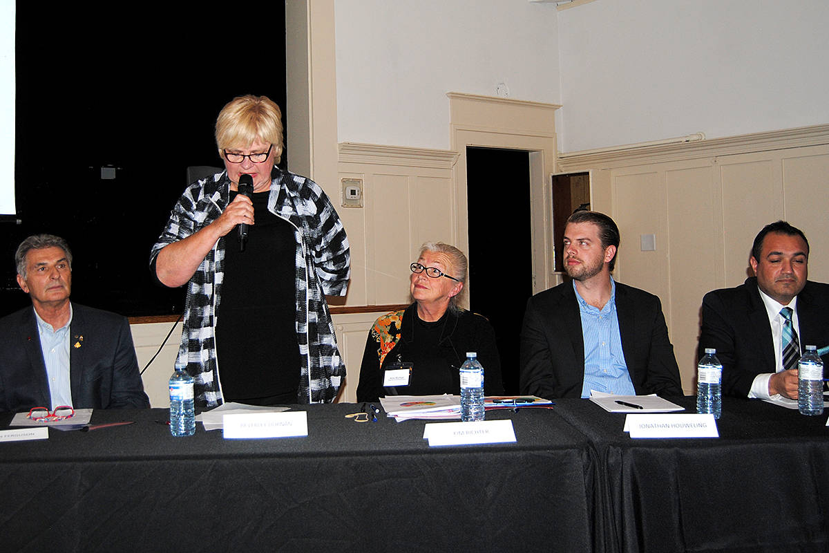 Bev Dornan speaks at the Fort Langley candidates' meeting Thursday. Listening are fellow candidates for the Langley Township council (from left) Steve Ferguson, Kim Richter, Jonathan Houweling and Sunny Hundal. (Frank Bucholtz/Black Press)