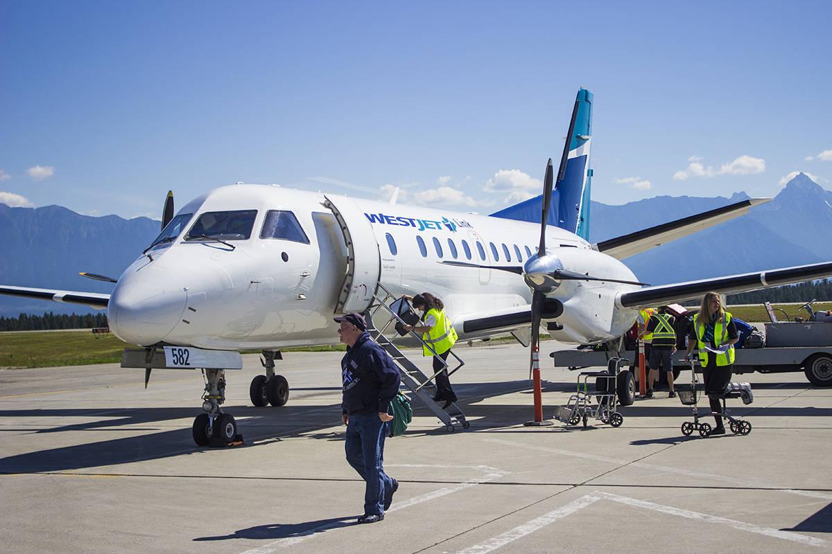 Passengers disembark from WestJet's first-ever flight into Cranbrook. Paul Rodgers photo.