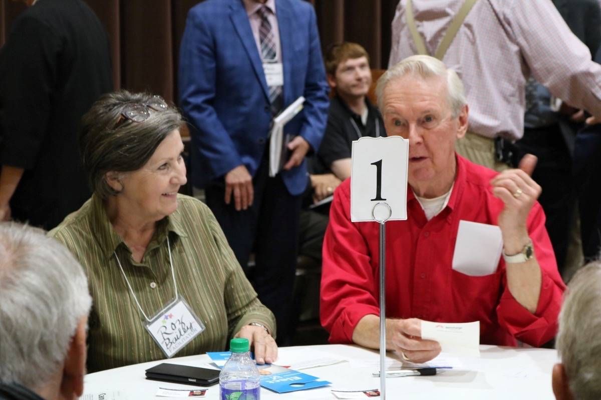 Participants discuss senior-specific questions at a City all-candidates meeting. Miranda Fatur Langley Times