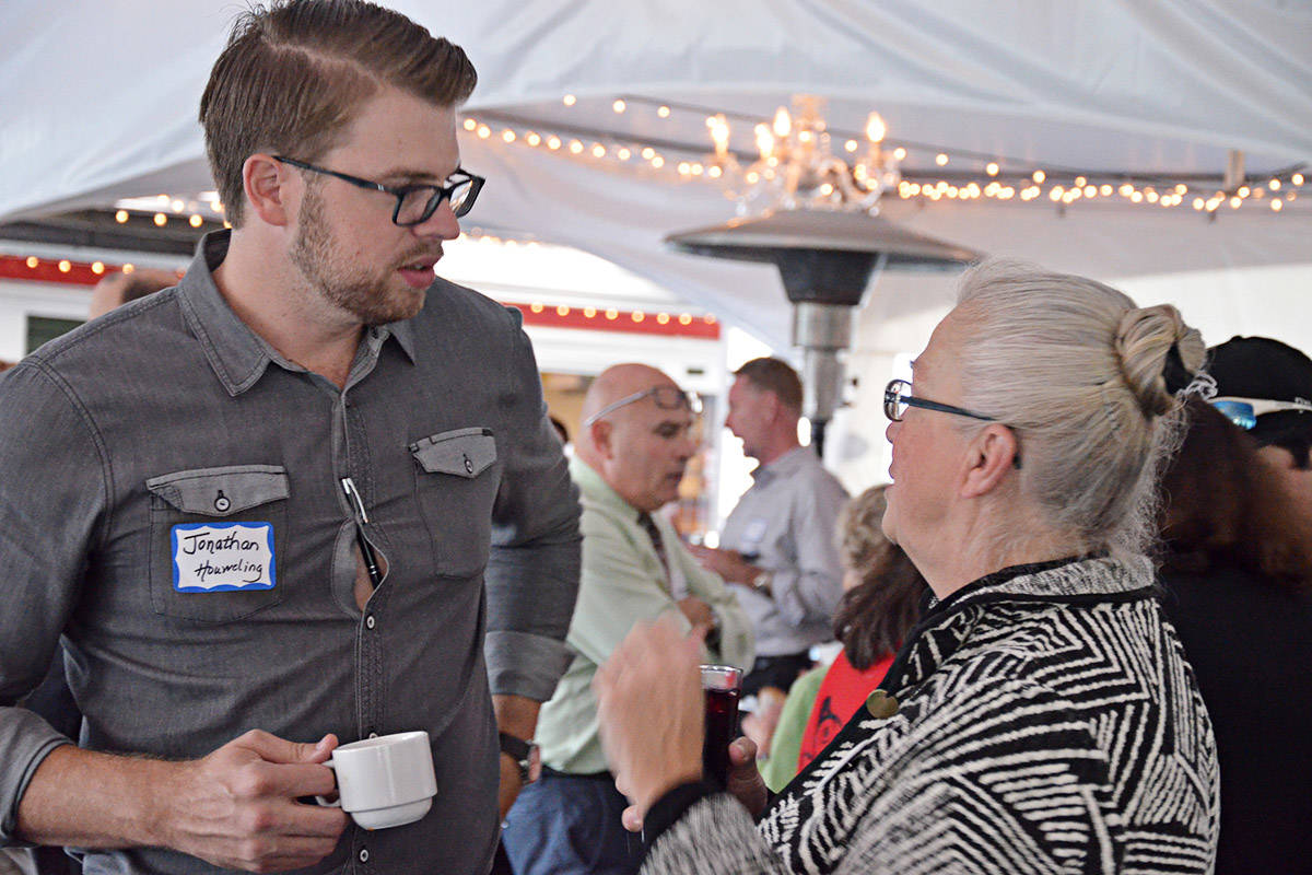 Council candidates Jonathan Houweling and Kim Ricther talked at the meet and greet. (Matthew Claxton/Langley Advance)