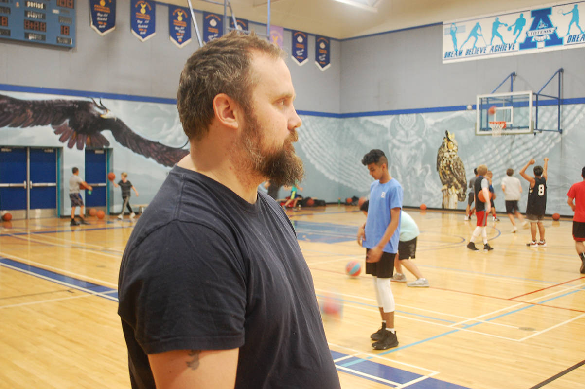 KURT LANGMANN PHOTO Aldergrove Basketball Club director Aaron Campbell keeps a watchful eye over the youths that attend the twice-weekly free open gym sessions.
