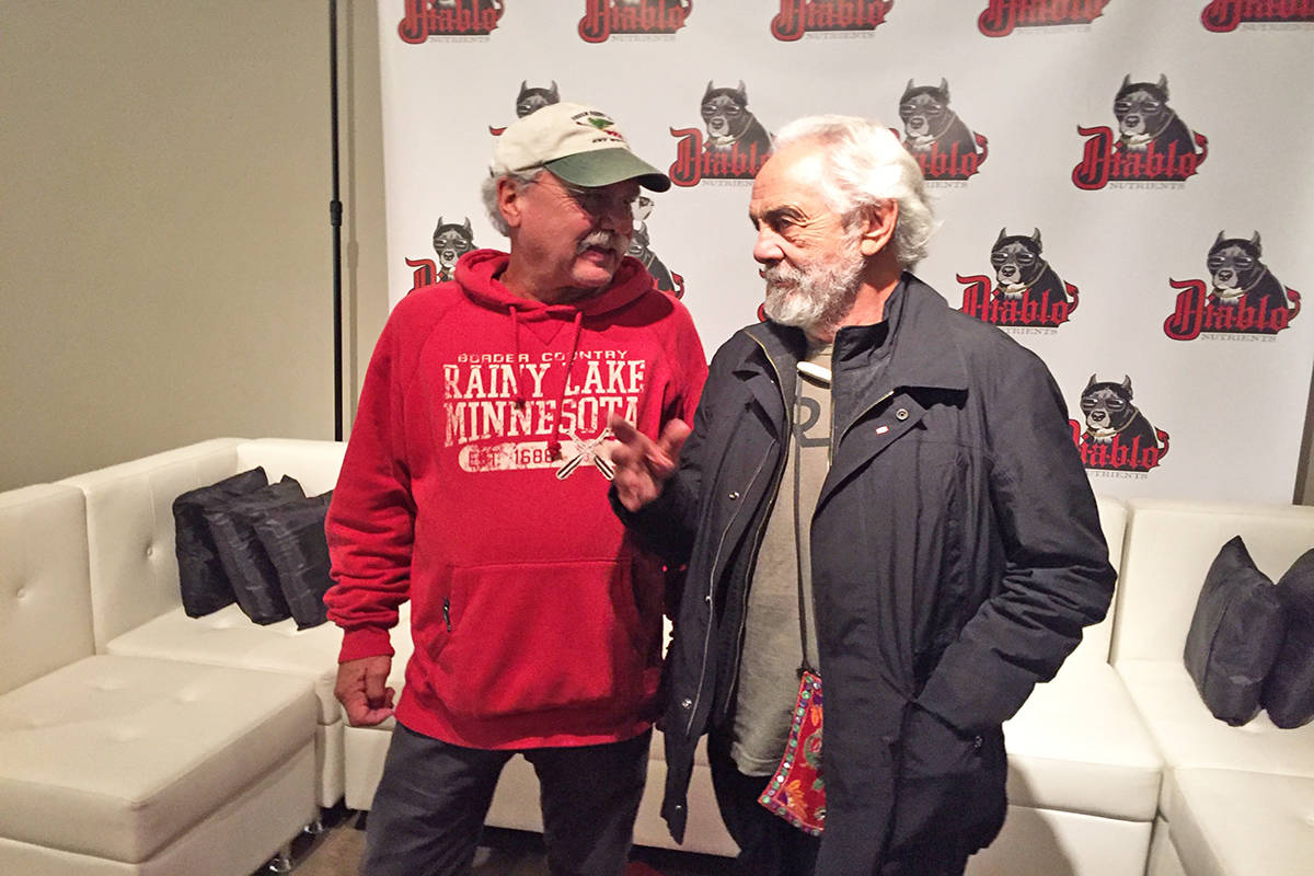 Brad McIntosh (left), from Minnesota, came to Canada to celebrate the legalization of cannabis on Oct. 17 and ventured to Kelowna for a chance to meet his comedic hero and marijuana advocate Tommy Chong. Photo: Barry Gerding/Black Press
