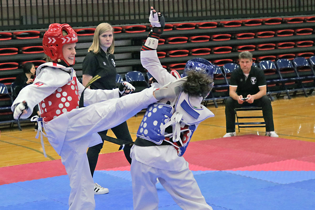 Woo Kim Langley Tae Kwon Do competitor Alexis Schoenroth (in red) took gold at the 2018 Washington State Governors Cup. Supplied photo