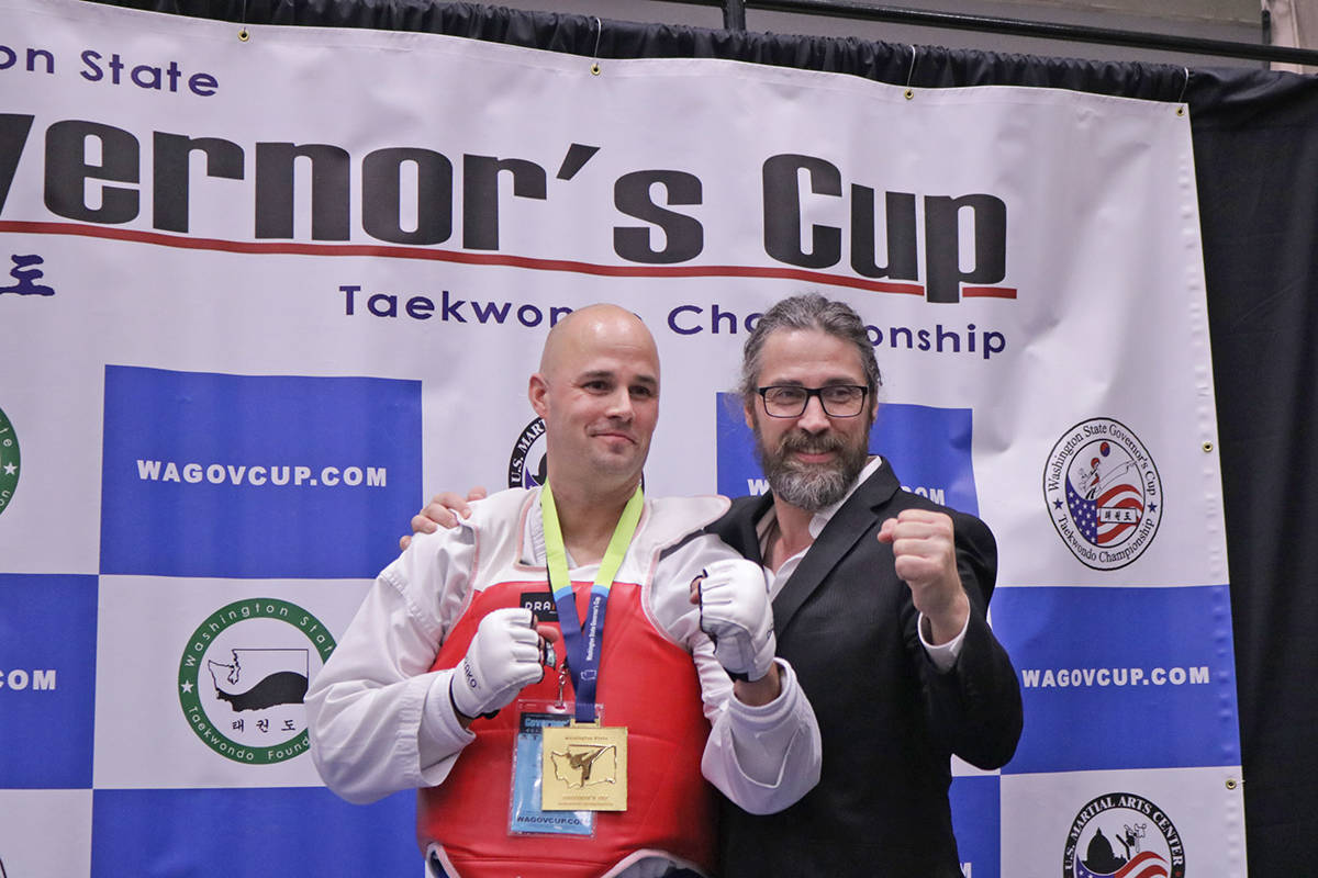 Woo Kim Langley Tae Kwon Do double gold medal winner Jeremy Strobiki at the 2018 Washington State Governors Cup with headmaster Gary McLaughlin. Supplied photo