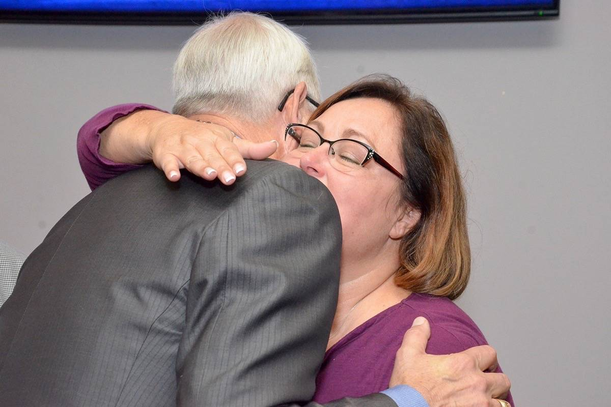 Mayor Jack Froese hugs council candidate Angie Quaale, who was not re-elected for a seat on council. Blackpress photo
