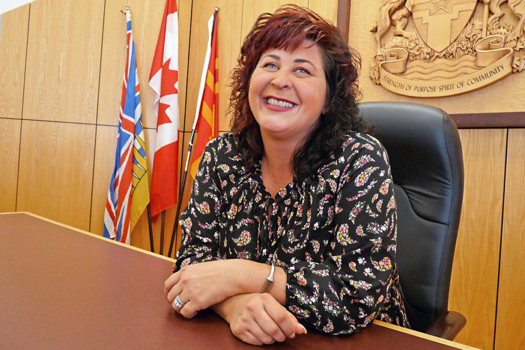 For the first time as mayor-elect, Val van den Broek tries out the Langley City mayor's chair in council chambers.                                 Dan Ferguson Langley Times