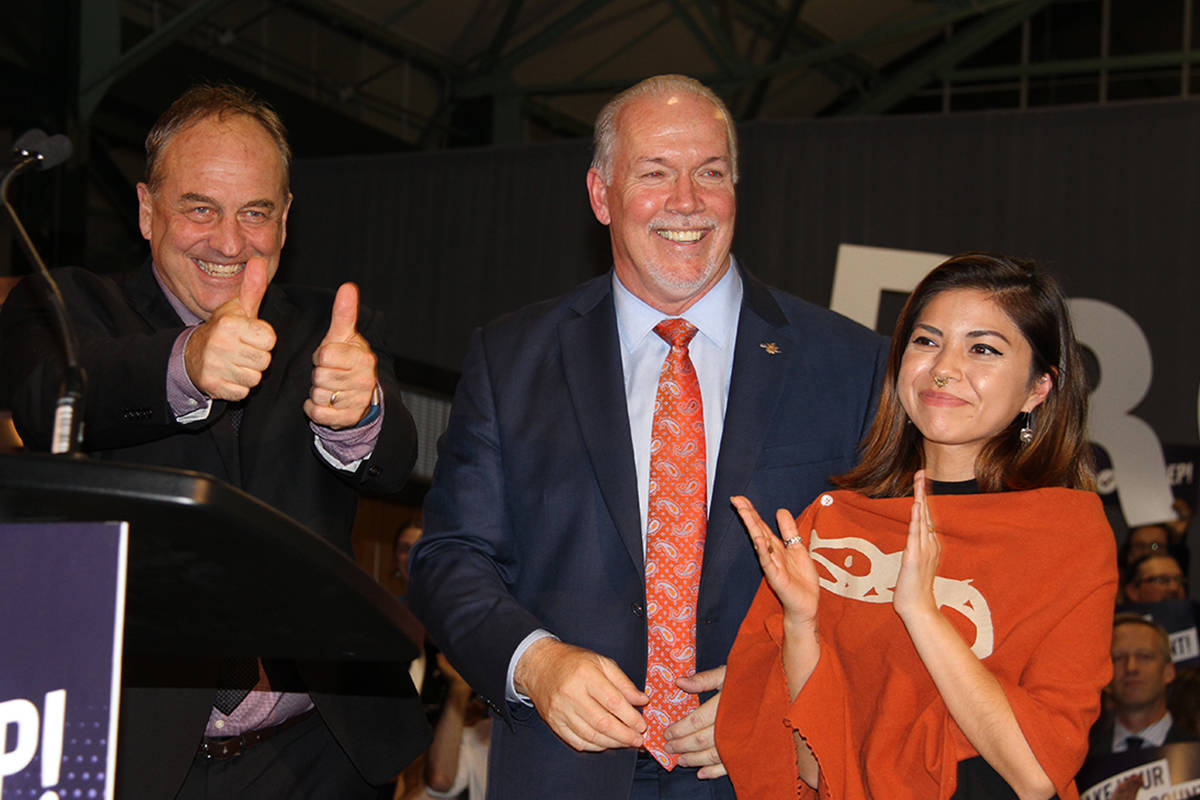 BC Green Party leader Andrew Weaver joins Premier John Horgan and Douglas College student Simka Marshall at a rally for proportional representation in Victoria, Tuesday. (Kristyn Anthony/News staff)