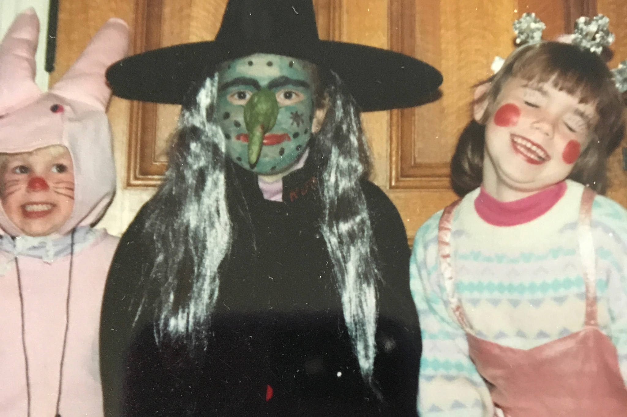 Submitted photo                                Nanoose resident Jessica McLaren, left, dresses as a bunny for Halloween in the early 90s to go trick or treating with her older sisters.