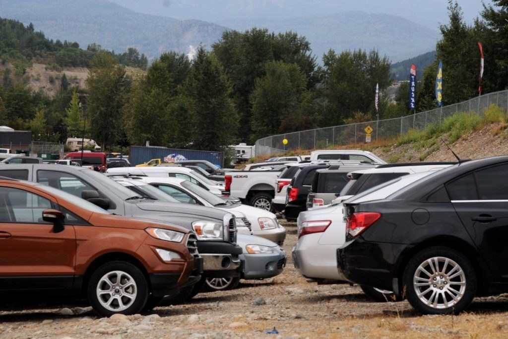 Dozens of vehicles of all makes and models, many appearing new, were lined up on a Highway 3B property in late summer. Marked as contaminated by the Trail acid spills, the cars, trucks, and SUVs were hauled off to the junk yard. (Sheri Regnier photo)