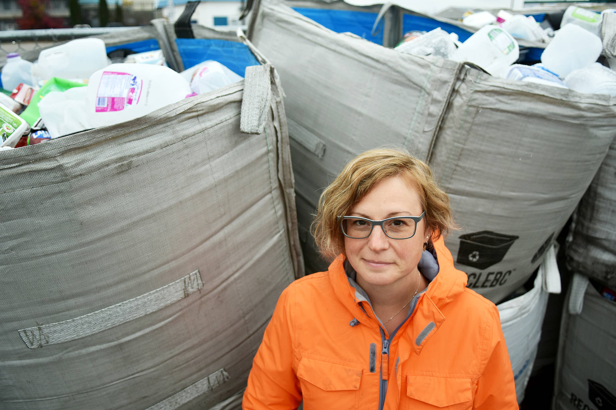 Chélie Elsom stands in front of bags of recyclable plastics in Salmon Arm, plastics that, in B.C., will be remanufactured into new items. Elsom has created a petition she hopes will be presented in the House of Common, asking for a national strategy that will prohibit the use of single-use plastic. (Lachlan Labere/Salmon Arm Observer)