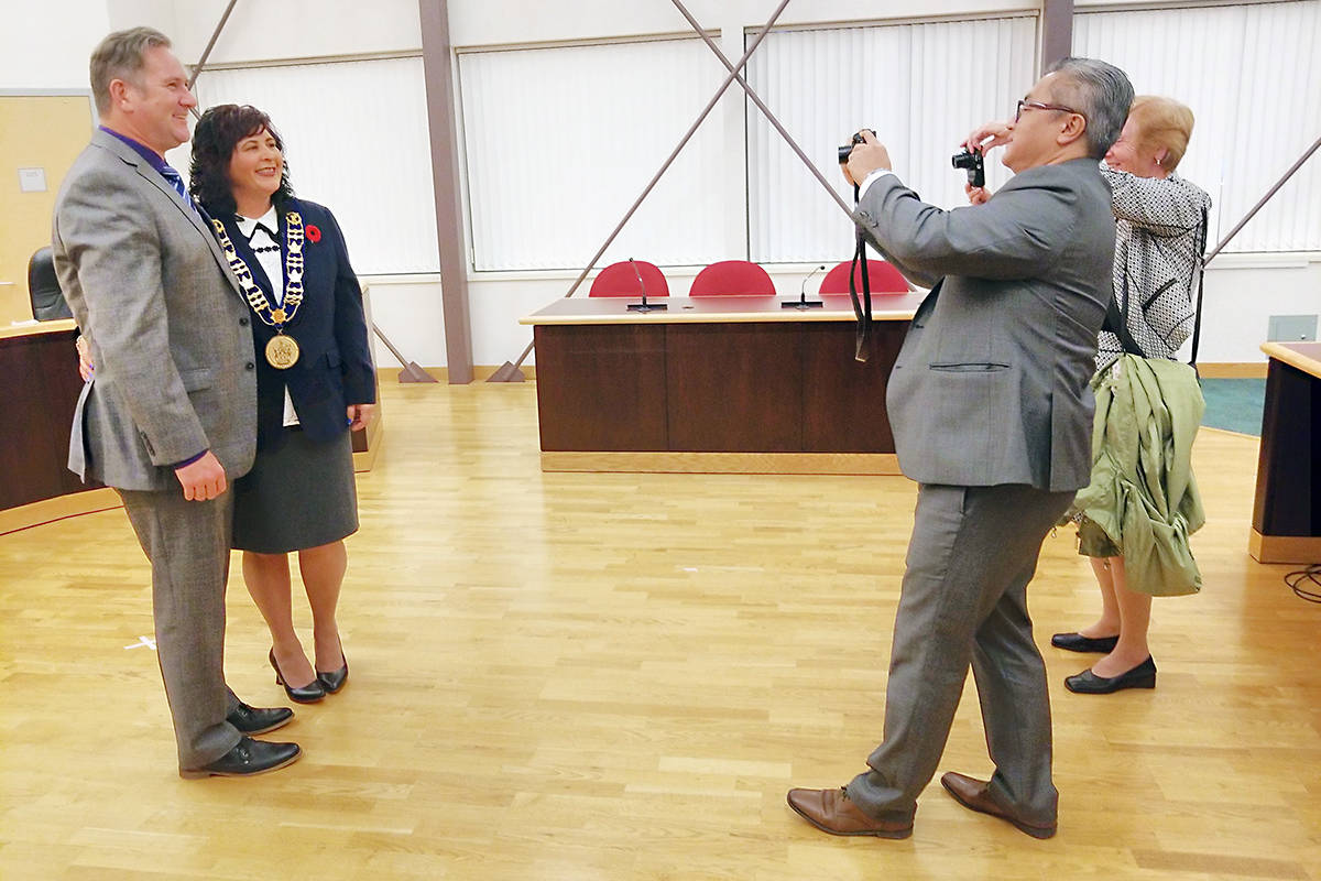 A few minutes after she was formally sworn in as mayor of Langley City, Val van den Broek and her husband Rob returned to the now-empty council chamber for pictures. Dan Ferguson Black Press
