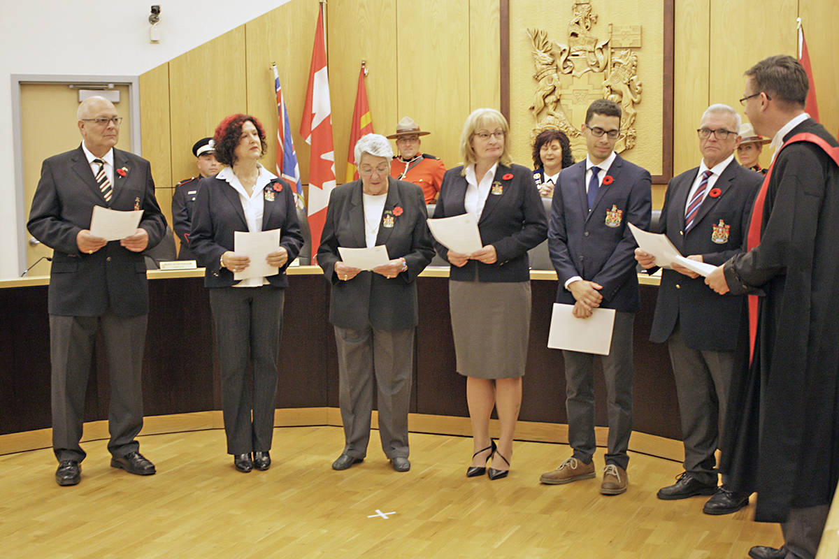 Judge Rob Hamilton swears in the new Langley City council. L to R, Rudy Storteboom, Rosemary Wallace, Gayle Martin, Teri James, Nathan Pachal and Paul Albrecht.Dan Ferguson Black Press