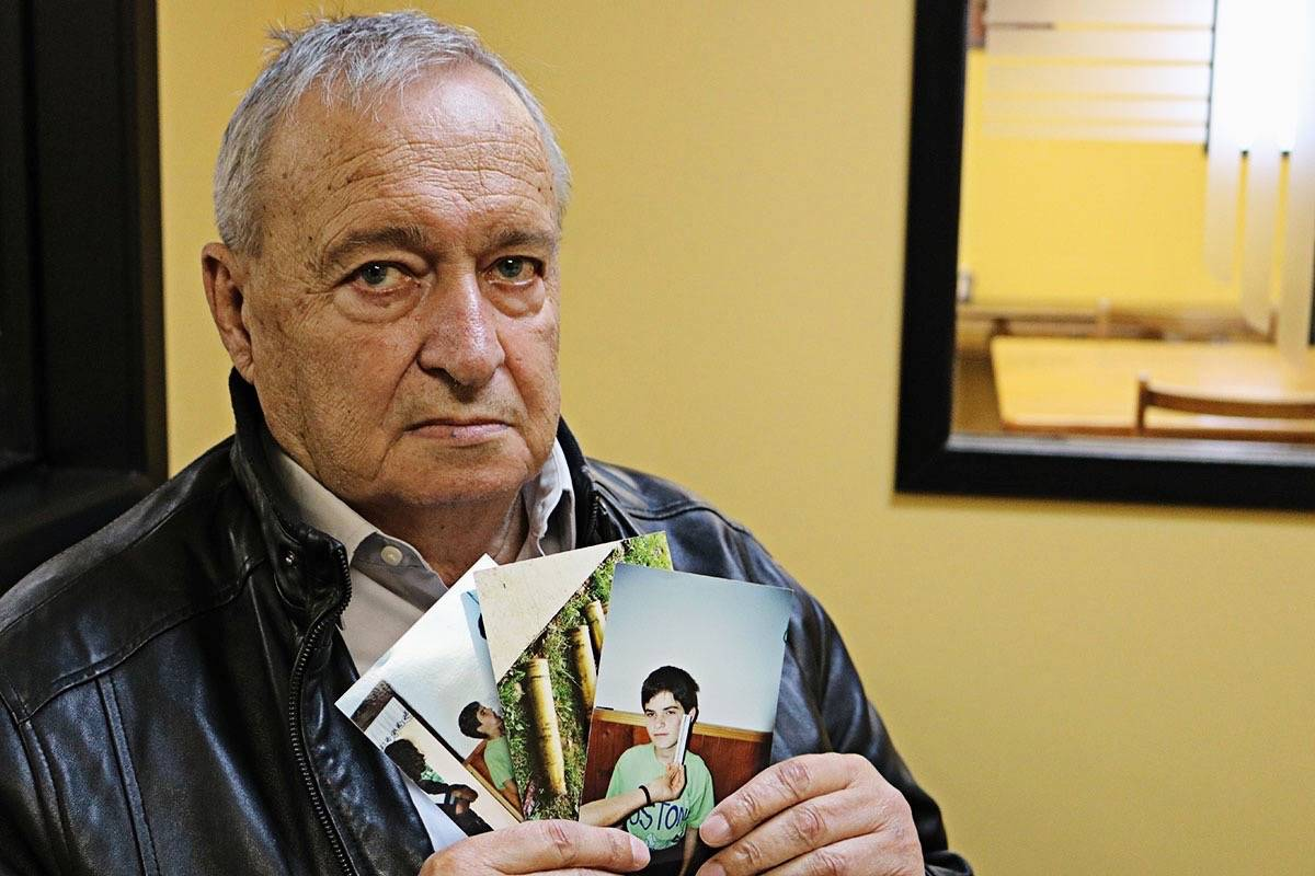Retired VPD officer Brian Honeybourn investigated war crimes in Kosovo in 1999. The photo he holds is an image of seven-year-old Vlora. Courtesy Brian Honeybourn