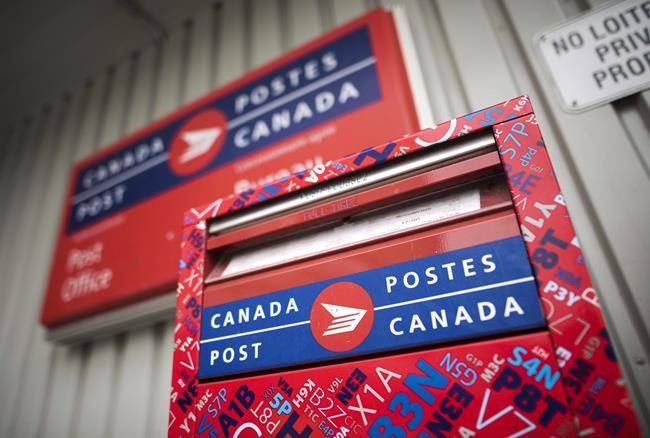 A mail box is seen outside a Canada Post office in Halifax. (THE CANADIAN PRESS/Darren Calabrese)