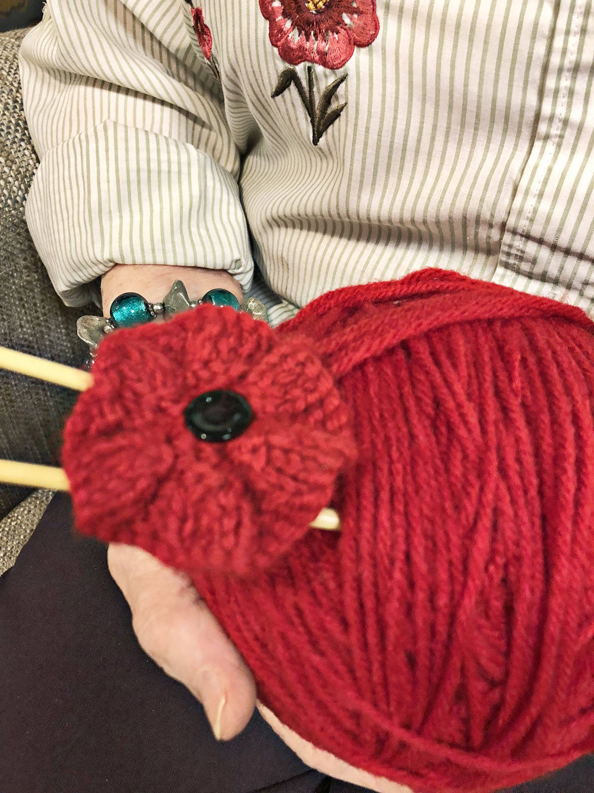 Irene Brummitt and some friends at Avalon Gardens knitted and sold poppies, donating the money to the Legion Poppy Fund. (Photo provided)