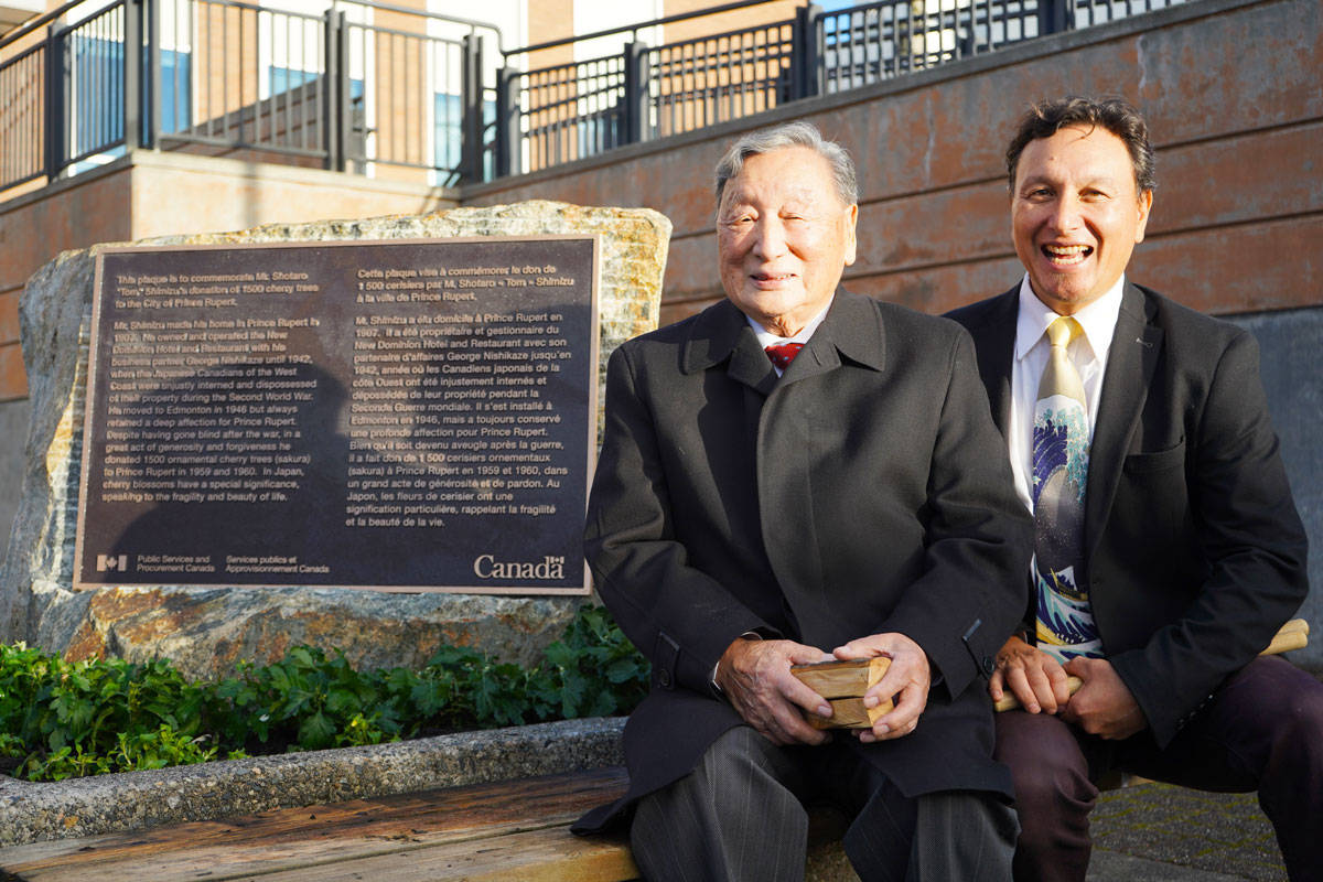 Henry Shimizu and his son Gregory at the newly installed monument dedicated to Shotaro Shimizu. (Shannon Lough / The Northern View)