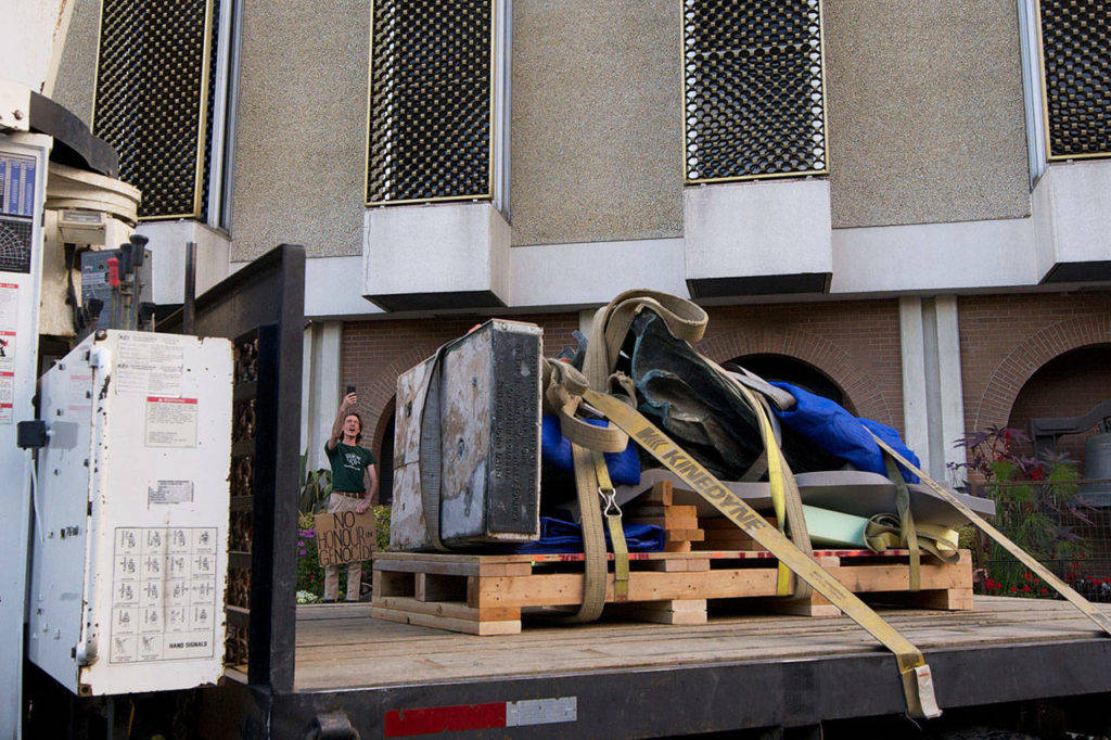 The Sir John A. Macdonald statue seen here being driven away from Victoria City Hall, cost more than $30,000 to remove Aug. 11, 2018. (Nicole Crescenzi/News staff)
