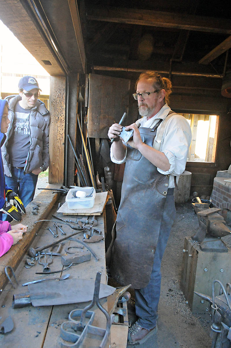 A blacksmith demonstrated the art to visitors at historic Fort Langley during Douglas Day. Black Press photo