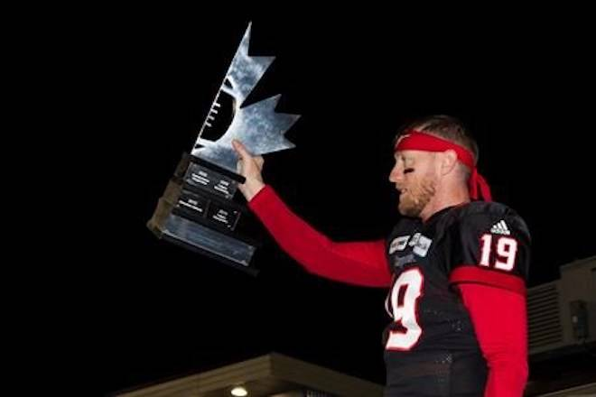 Calgary Stampeders' quarterback Bo Levi Mitchell hoists the West Division Trophy after they defeated the Winnipeg Blue Bombers during the CFL West Final in Calgary, Sunday, Nov. 18, 2018.THE CANADIAN PRESS/Todd Korol