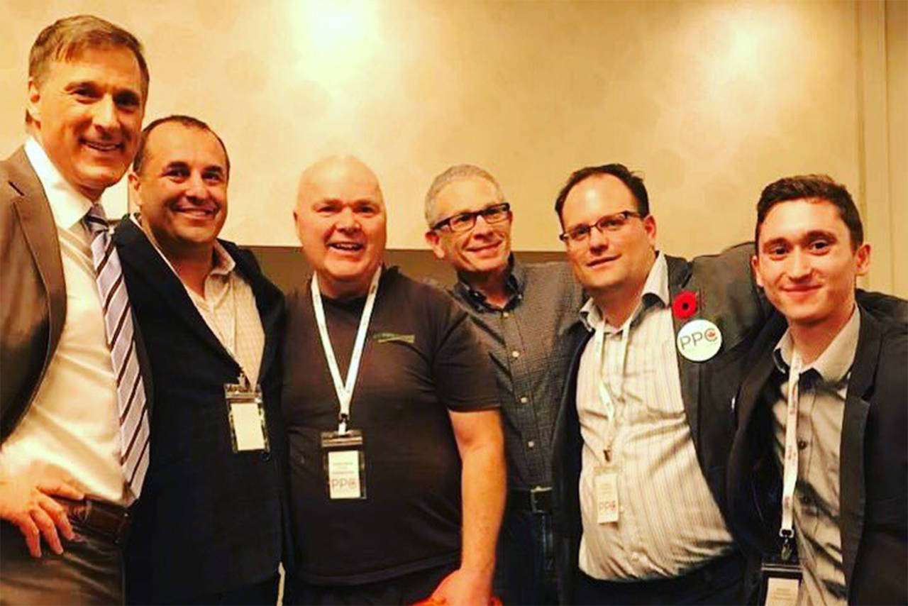 People's Party of Canada founder Maxime Bernier (left) along with (from left to right) Kelly Watt, Fredrick Burns, Paul Middleton, Ben Besler and Yale Gibson. (Photo by Jessica Flynn)