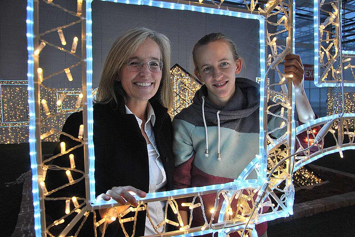Event co-founder Tamara Jansen and her daughter Breanne Kanis showed off fixtures that were made in China this year for inclusion in the latest Glow Christmas display at their family greenhouses. (Black Press photo)