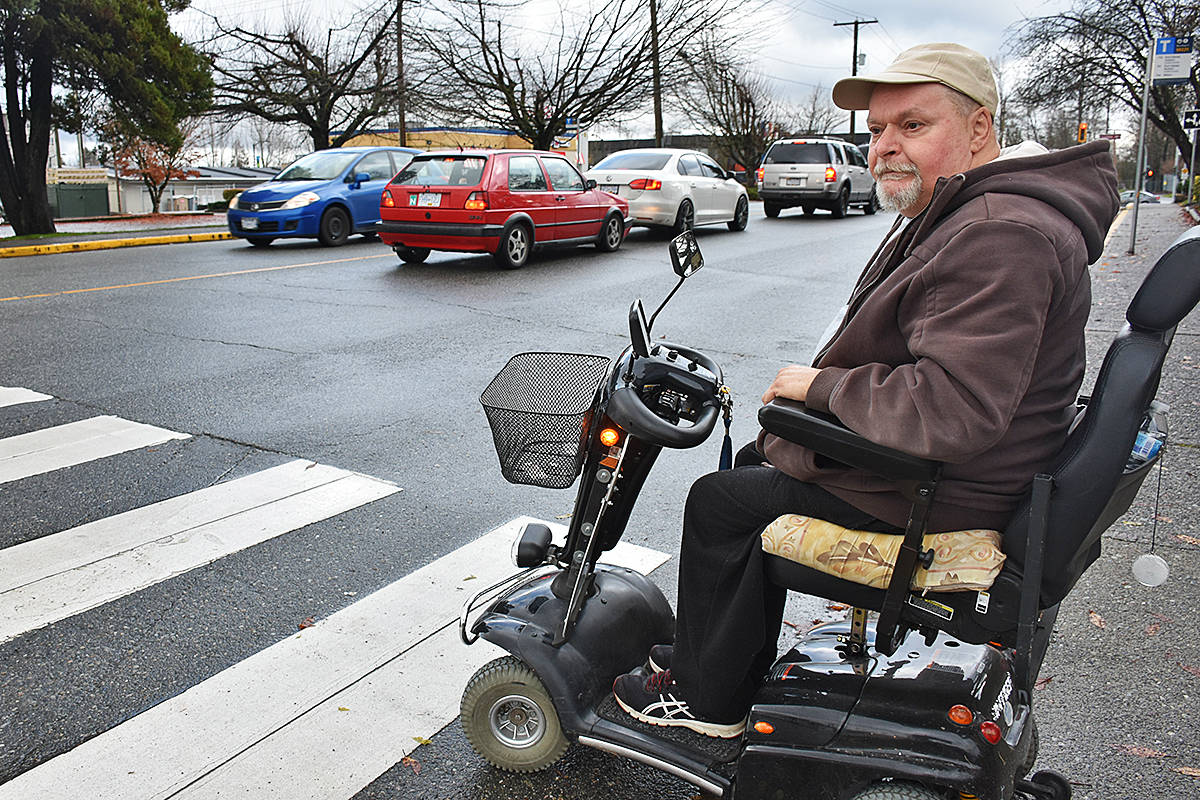 Craig Severn said he does not feel safe crossing streets in Maple Ridge after being hit and having numerous close encounters with vehicles. He wants to see more pedestrian controlled crosswalks. (Neil Corbett/THE NEWS)