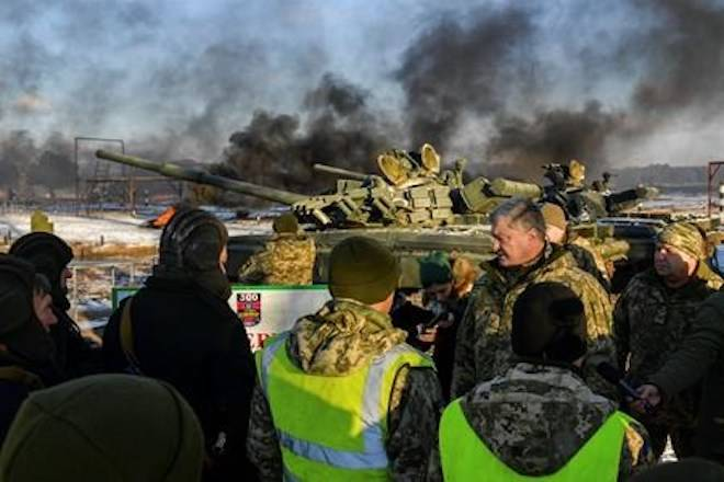 Ukrainian President Petro Poroshenko, second from right, speak with soldiers during a military training at a military base in Chernihiv region, Ukraine, Wednesday, Nov, 28, 2018. Russia and Ukraine traded blame after Russian border guards on Sunday opened fire on three Ukrainian navy vessels and eventually seized them and their crews. The incident put the two countries on war footing and raised international concern. (Mykola Lazarenko, Presidential Press Service via AP)