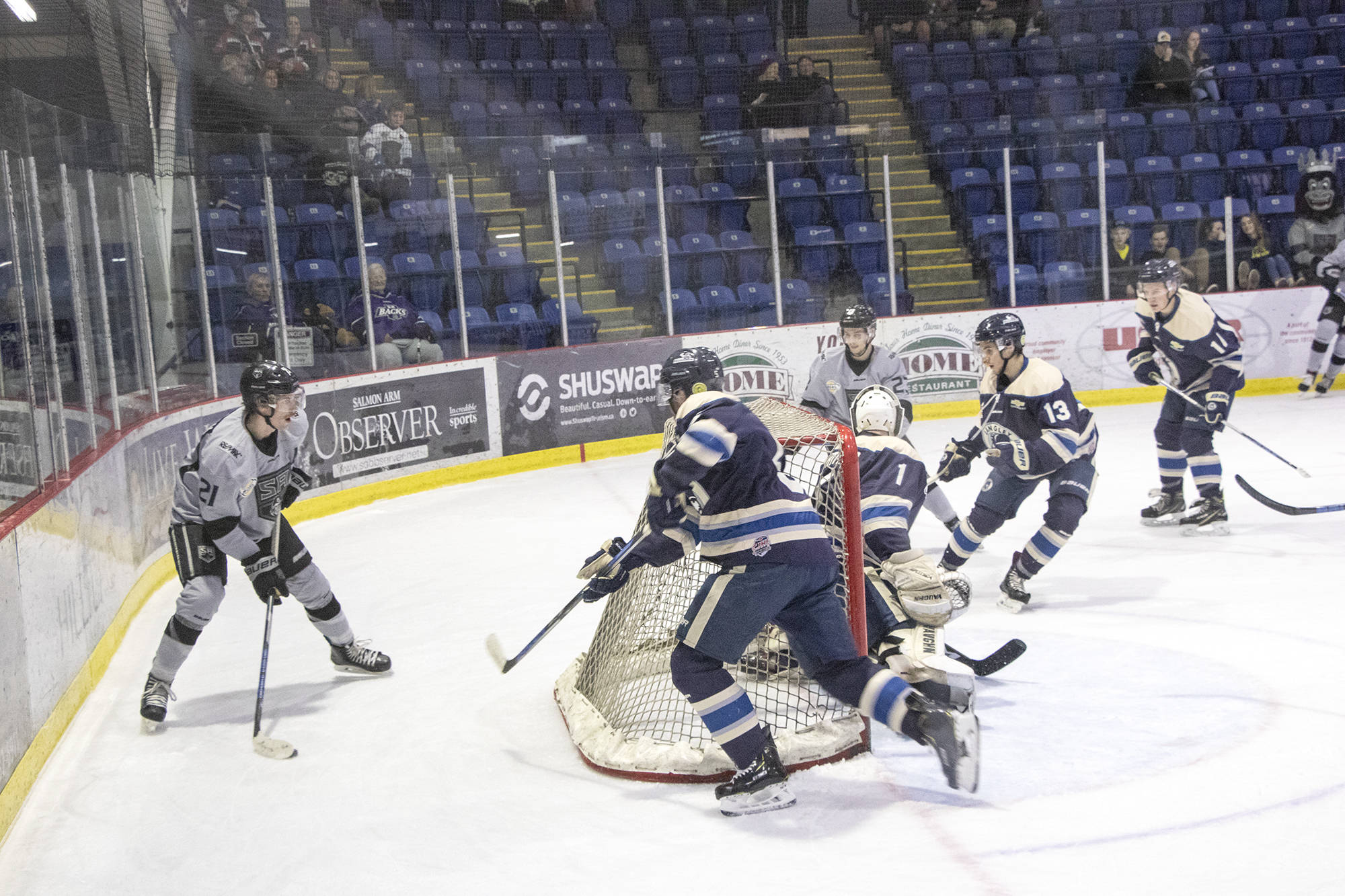 Justin Wilson of the Silverbacks controls the puck behind Langley's goal, keeping eyes up for passing options as the Rivermen close in during the Nov. 28 game in Salmon Arm. (Jodi Brak/Salmon Arm Observer)
