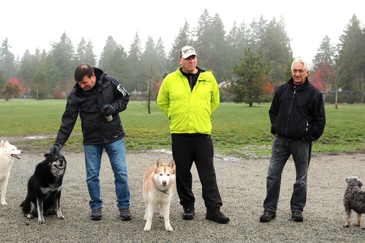 (left) Layne Pennington, Dave O'brien, and Victor Loski are regulars at Uplands Dog Park and they believe John Levesque and Cameron should not have been banned. Miranda Fatur Langley Times