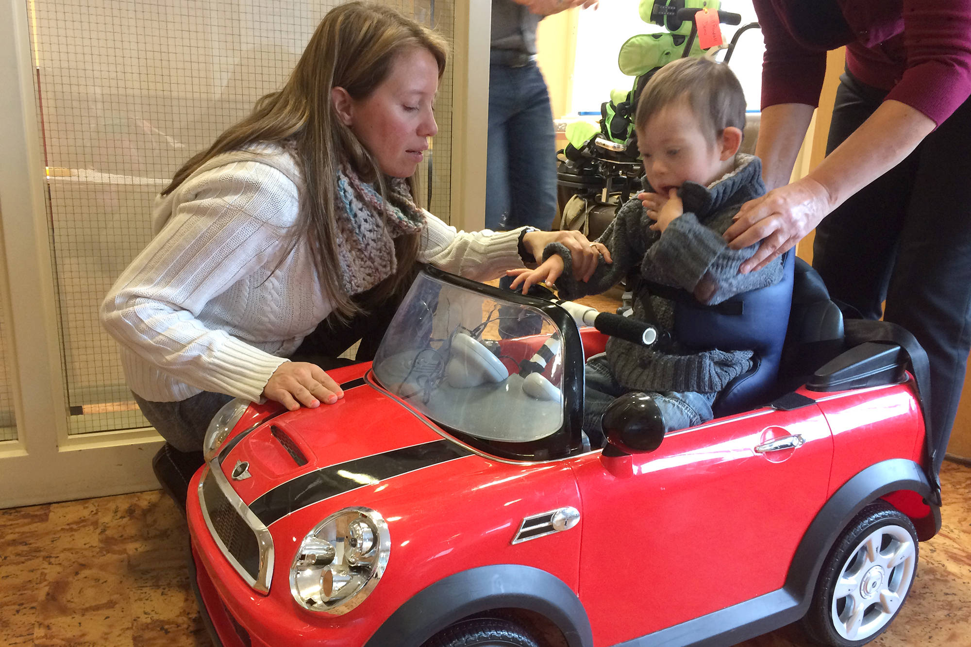 Shuswap Children's Association physiotherapist is Estera Hazlewood is teaching four-year-old Oli Brooks how to push a button on an adaptive car. The association is unable to provideOli with the number of hours he requires for his complex needs. (Zev Tiefenbach photo)