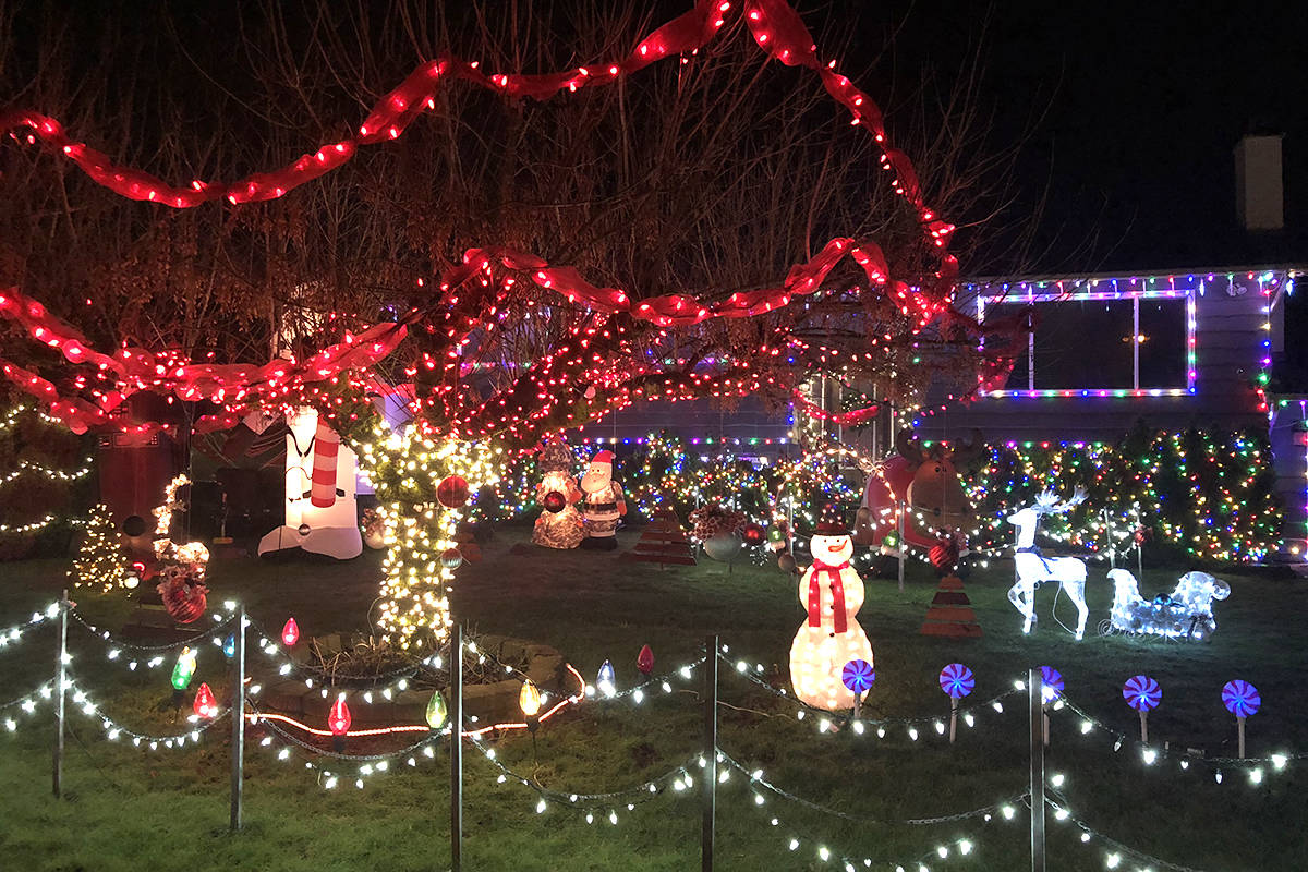 Troy Warren's house is decked out in lights and inflatables. Courtesy Troy Warren