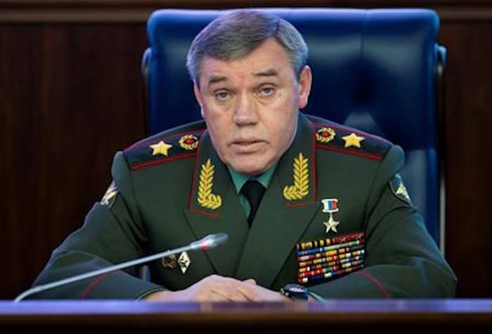 """Deputy Chief of General Staff of Russia, Valery Gerasimov delivers his speech during a briefing in the Russian Defense Ministry's headquarters in Moscow, Russia, Wednesday, Dec. 5, 2018. Gerasimov told a briefing of foreign military attaches on Wednesday that if the U.S. """"were to destroy"""" the treaty """"we will not leave it without a response."""" (AP Photo/Alexander Zemlianichenko)"""