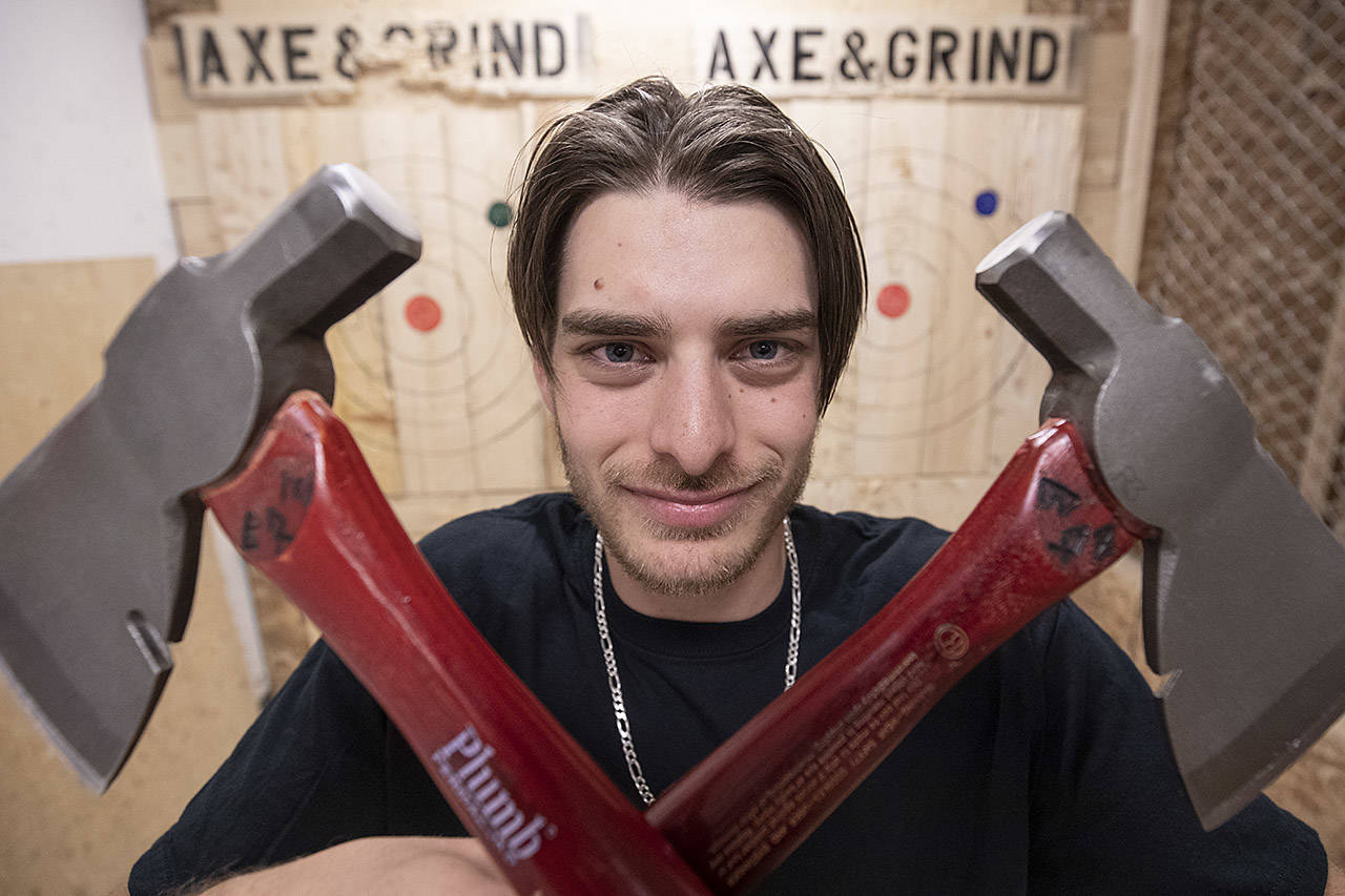 """Bullseye"" Boz, also known as Ben Bosworth has won the Axe & Grind's axe throwing league twice, earning him a spot in the World Axe Throwing League Championships in Chicago Dec. 15. (Arnold Lim/Black Press)"