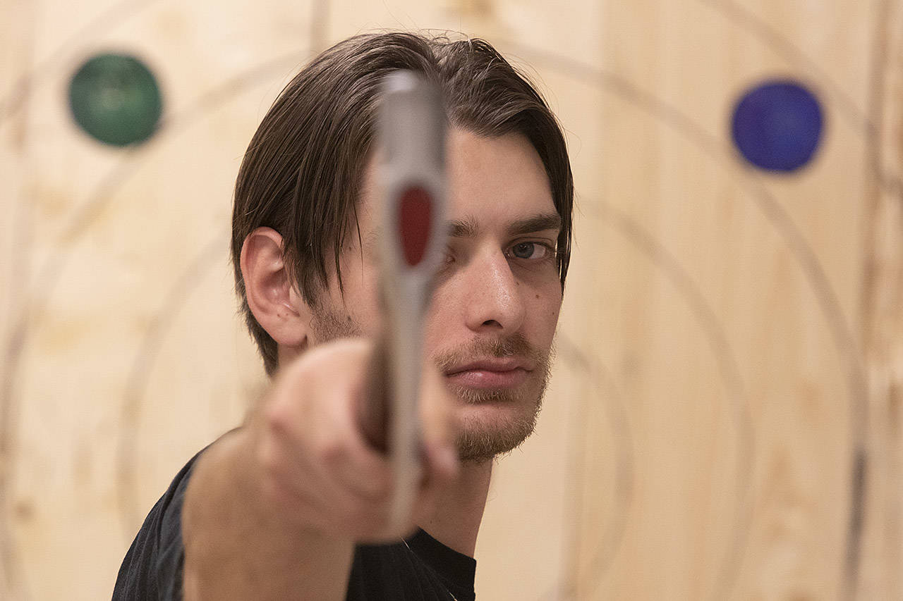 """""""Bullseye"""" Boz, also known as Ben Bosworth has won the Axe & Grind's axe throwing league twice, earning him a spot in the World Axe Throwing League Championships in Chicago Dec. 15. (Arnold Lim/Black Press)"""