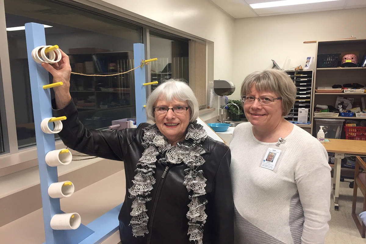 Rita Wiens and her daughter Sharon Campbell, an occupational therapist with Interior Health, standing next to a physiotherapy exercise device at Kelowna General Hospital. Photo: Barry Gerding/Black Press