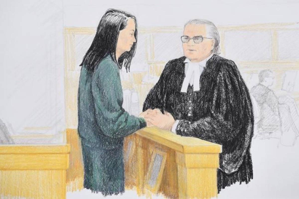 In this courtroom sketch, Meng Wanzhou, left, the chief financial officer of Huawei Technologies speaks to her lawyer David Martin during a bail hearing at B.C. Supreme Court in Vancouver, on Monday, December 10, 2018. (Jane Wolsak/The Canadian Press)