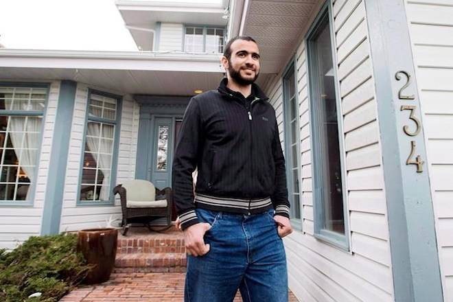 Omar Khadr walks out the front door of his lawyer Dennis Edney's home to speak the media in Edmonton, Thursday, May 7, 2015. THE CANADIAN PRESS/Nathan Denette