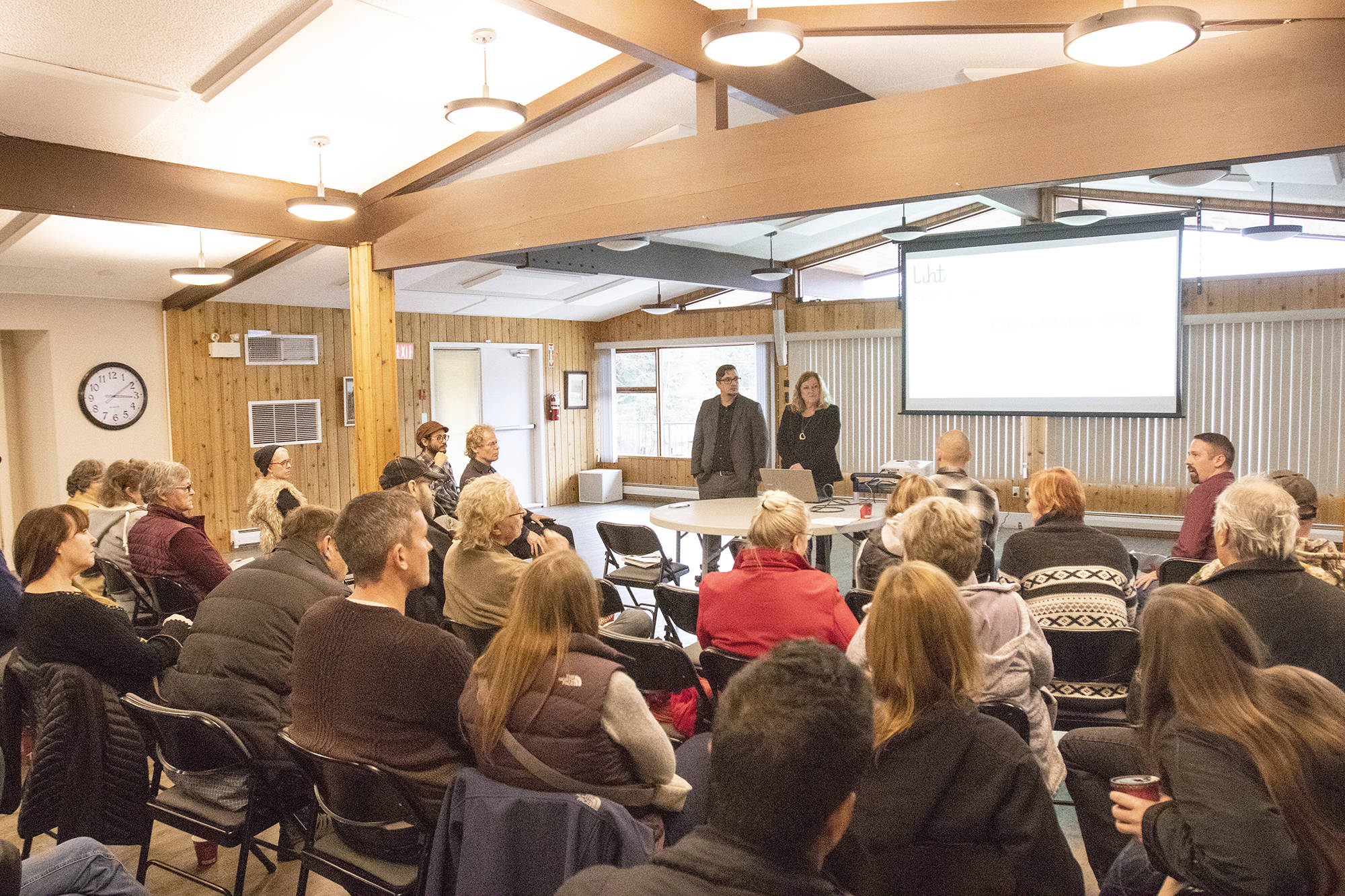 Liht Cannabis Corp's independent director Richard Huhn and chief operating officer Linda Sampson speak to the crowd gathered during a public information session at the Cedar Heights Community Association in Sorrento, Nov. 17, one of two public meetings held. (Jodi Brak/Salmon Arm Observer)