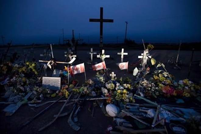 A memorial made of hockey sticks, crosses and Canadian flags is seen at the crash site of the Humboldt Broncos hockey team near Tisdale, Sask., Friday, August, 24, 2018. THE CANADIAN PRESS Jonathan Hayward