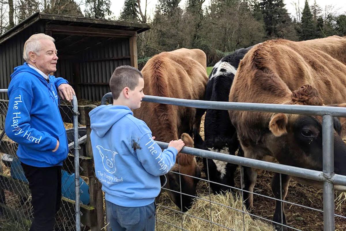 Matthew Farden (right) took mister Blake (left) on a tour of The Happy Herd sanctuary farm in Aldergrove. Courtesy Traci Farden