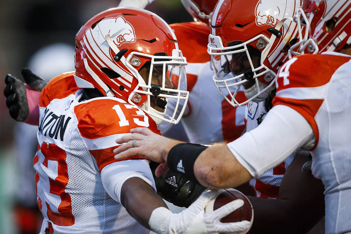 BC Lions' Tyrell Sutton, left, celebrates his touchdown with teammates during CFL football action against the Calgary Stampeders, in Calgary, Saturday, Oct. 13, 2018. (Jeff McIntosh/The Canadian Press)