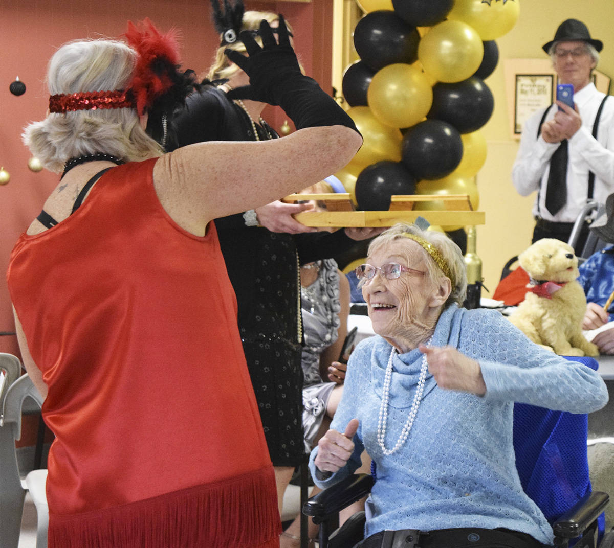 """The Pines Special Care Home in Kimberley celebrated Mother's Day this year with a roaring 20's themed party and staff had invited The Bulletin to take photos. What a special event. It was so lovely to be a part of this day and to see all of the people who are in special care dancing and having so much fun. I put a smile on my face for the rest of the day. Between the costumes, music, photo booth and 'mocktails' it truly felt like you had stepped back in time when walking through the doors of the cafeteria."" (Corey Bullock/Kimberley Bulletin)"