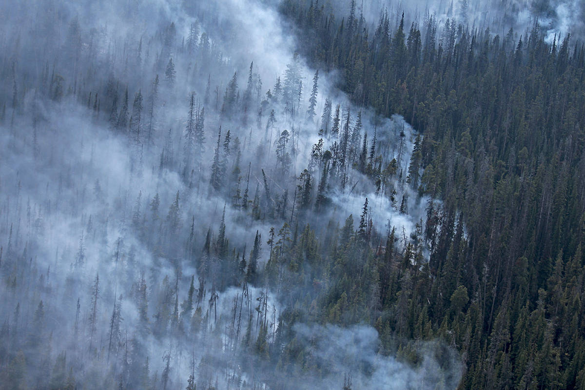 """This photo was one of the many cool shots I was able to take on my heli-tour with BC Wildfire Services this summer. The team wanted to show off some wins they had been having, so they invited me to get shots of the ongoing wildfires in the area. For anyone who is new to helicopter photography like I was, this was shot out of a small opening in the window as we were soaring 4,500 to 6,000 ft - so it took extra care to be steady and find the shot, all within a matter of seconds."" (Jordyn Thomson/Penticton Western News)"
