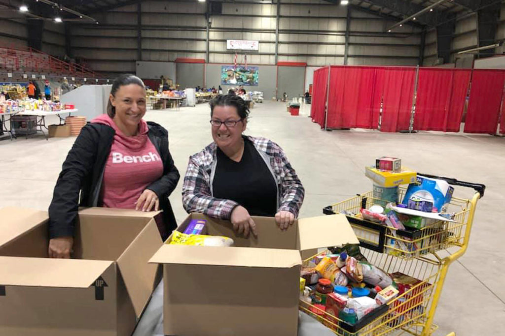 Volunteers help pack Christmas hampers at the Cloverdale Agriplex. (Cloverdale Christmas Hamper Program / Facebook)