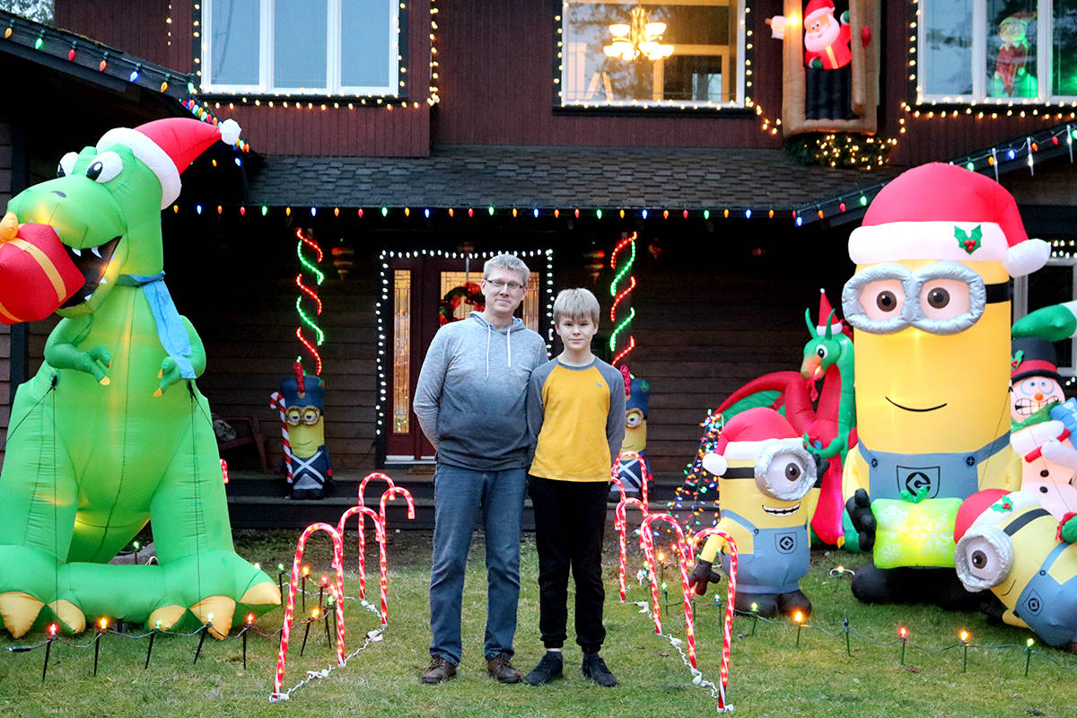 Cory Langford (left) and his son Rocco Langford spend hours together decorating the yard with inflatables and lights. Miranda Fatur Black press