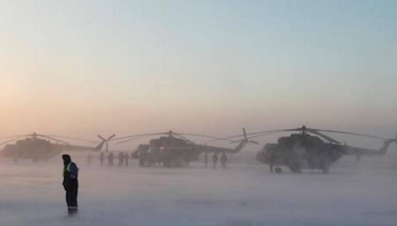 Search and rescue helicopters are seen before a flight to the landing area of the Soyuz MS-09 capsule with the International Space Station (ISS) crew onboard during sunrise in the town of Zhezkazgan, formerly known as Dzhezkazgan, Kazakhstan, Thursday, Dec. 20, 2018. (Shamil Zhumatov/Pool Photo via AP)