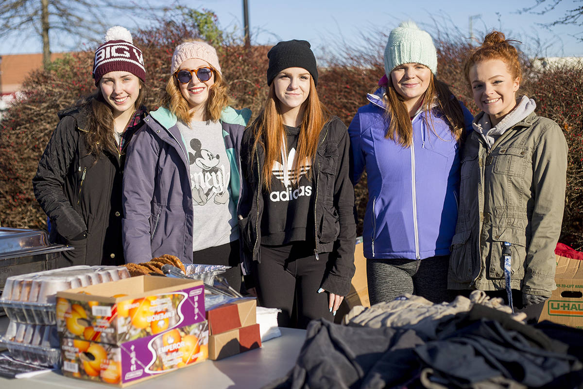 From (left) Georgia Sharp, Lacey Hall, Cierra Foster, Hannah Hall, Shayla Foster all helped out at last year's donation drive and hand out. Courtesy Danielle Campani